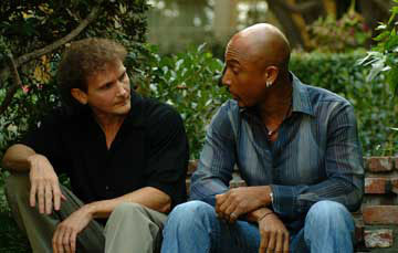 Chet Cooper talking with Montell Williams