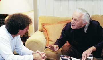 Chet Cooper speaking with Kirk Douglas at his home in Beverly Hills